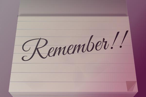 notitieblok met het woord remember